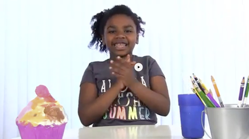 Young girl clapping on the set of Circle Time Magazine